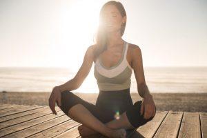 Women Having A Time Meditating On The Beach